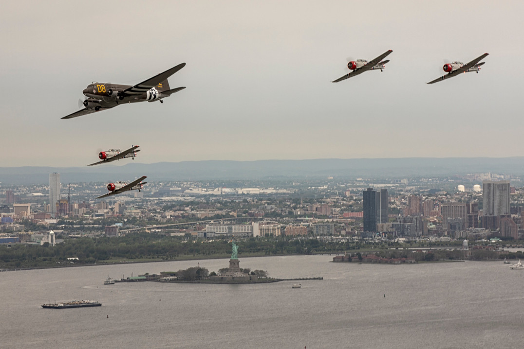 """C-47 """"D8"""" in Formation with the Geico Skytypers over the Statue of Liberty"""