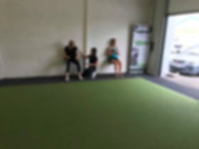 Female personal trainer coaching two females in Holmes Chapel