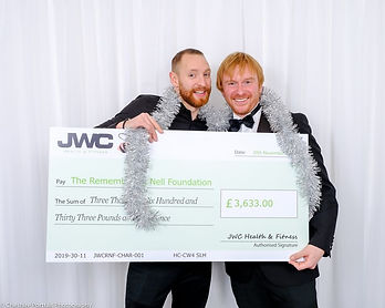 JWC and the Remembering Nell Foundation celabrate raising money with a giant cheque