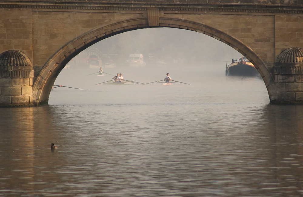 Photography in Henley. Rowers approaching a bridge in Oxford.