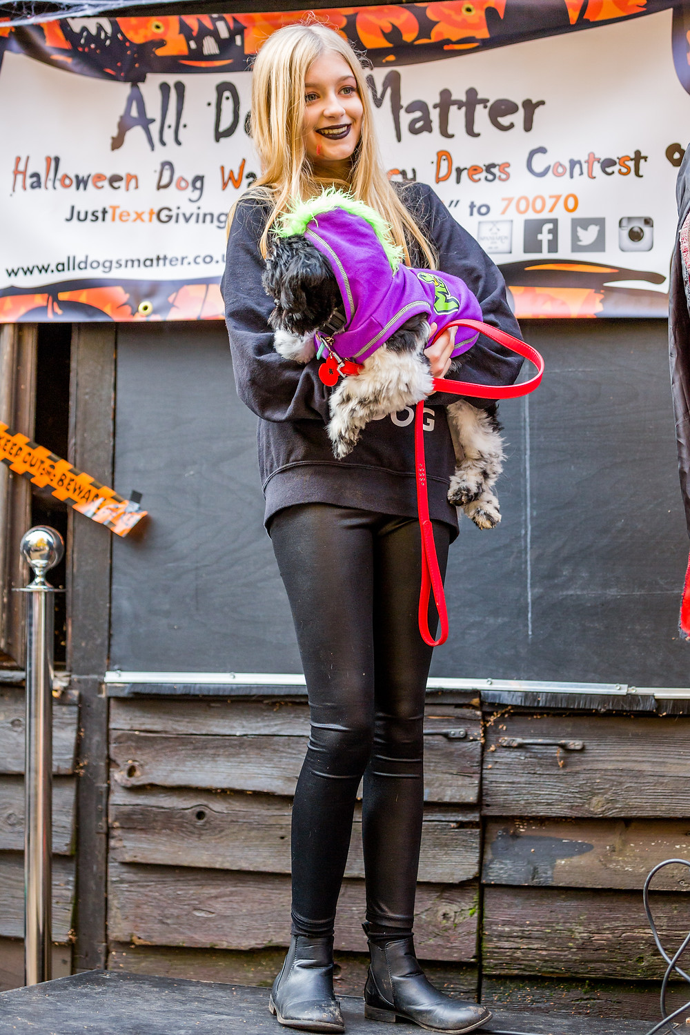 Dog photography in London. All Dogs Matter Halloween Charity Event. Volunteer and dog in fancy dress