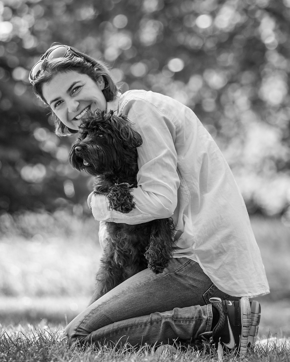 Dog photography in London. Franky the Schnoodle with his owner in Hyde Park.