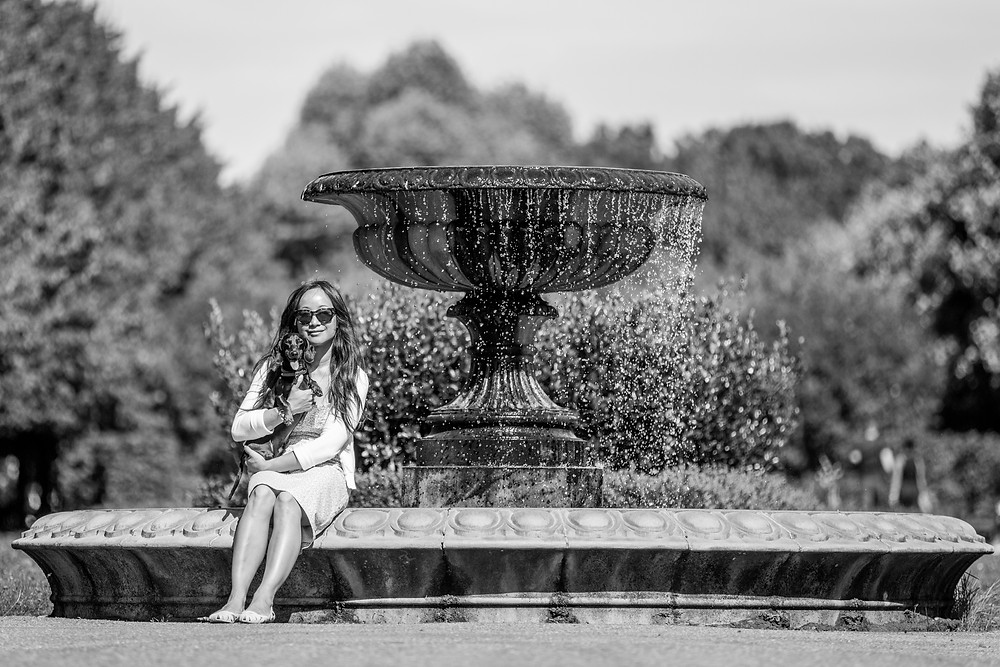 Dog photography in London. Dachshund - Dexter with his owner by the fountain in Regents Park