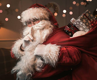 santa-claus-with-finger-on-the-lips-pict