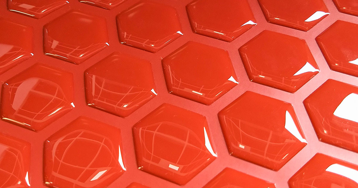 pastilha adesiva resinada - colméia vermelho