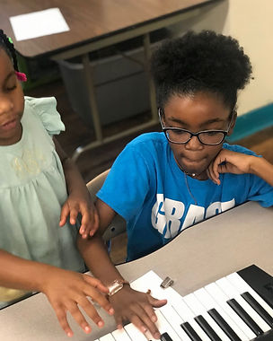 MEOW Academy students working in piano lessons in Montgomery, Alabama