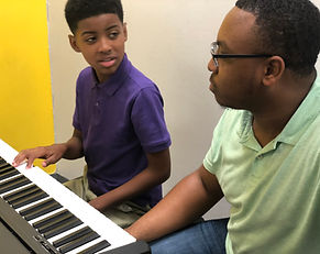 MEOW Academy teaching a piano student in Montgomery, Alabama.