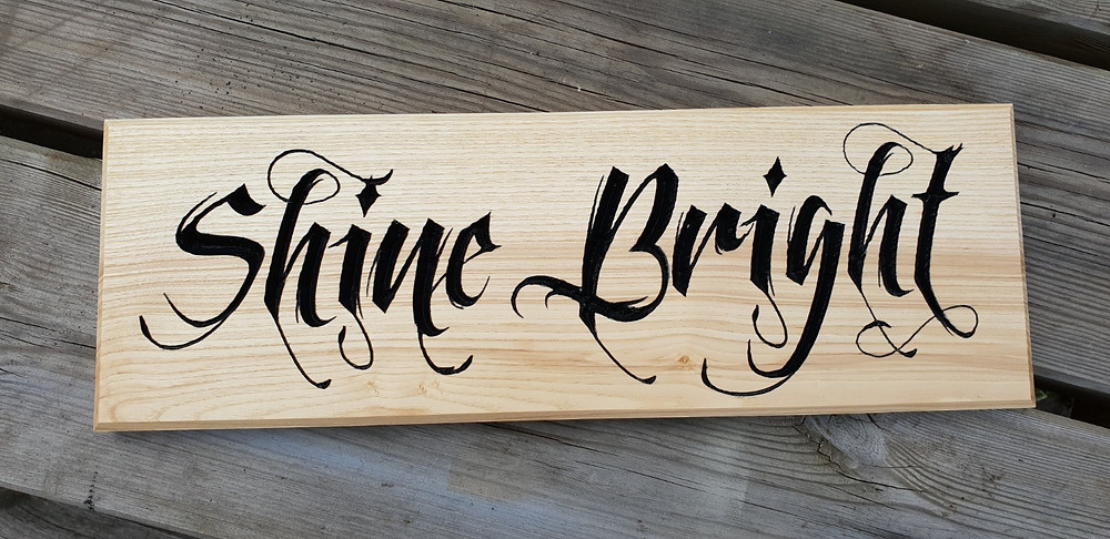 Shine Bright carved olive ash sign