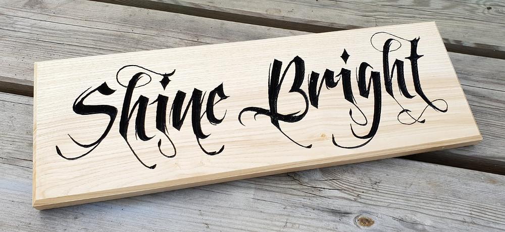 Shine Bright carved olive ash sign