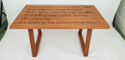Engraved lyrics table