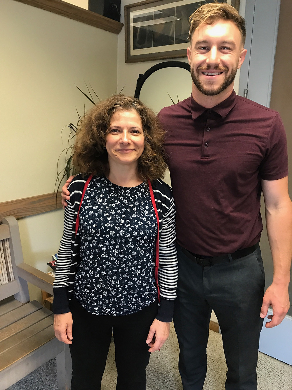 Dr. Ryan Moore with a client satisfied with her chiropractic care!