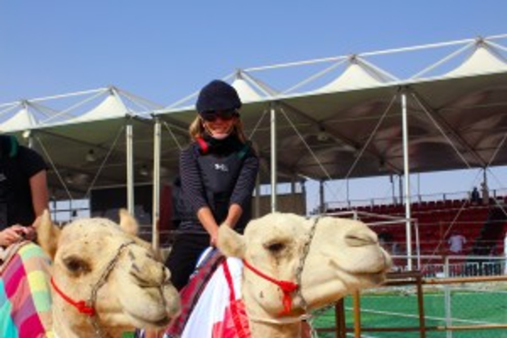 Lizzy of arabia on a camel at Al Dhafra Camel Beauty Pageant_UAE A-Z