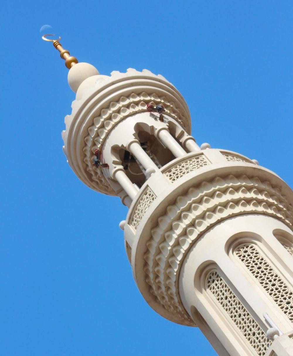 Moon over Al Shahama Mosque