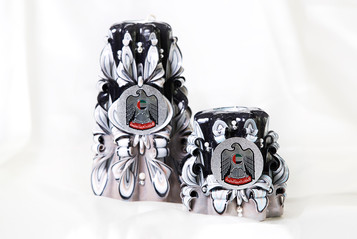 Black and white candles with logo
