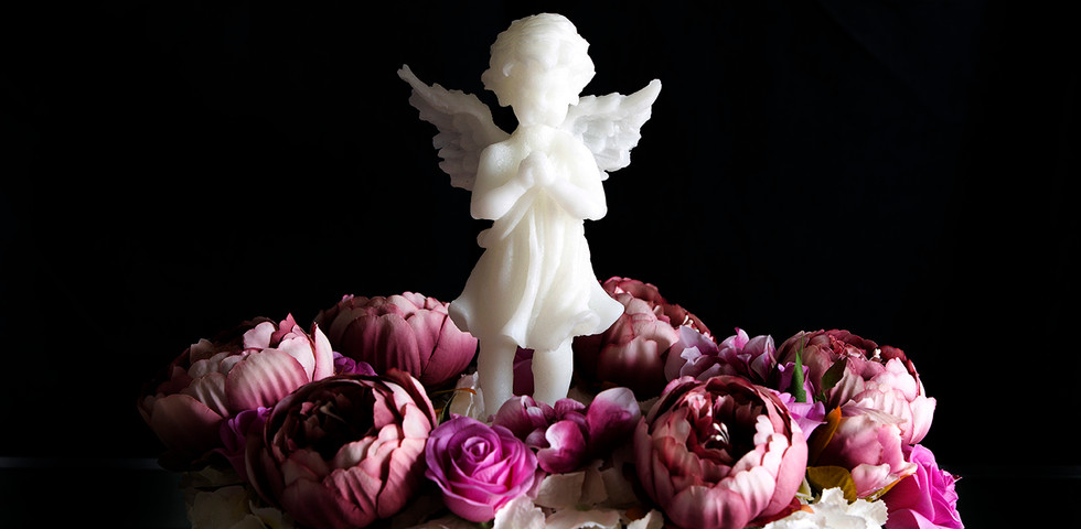 Angel candle with flowers