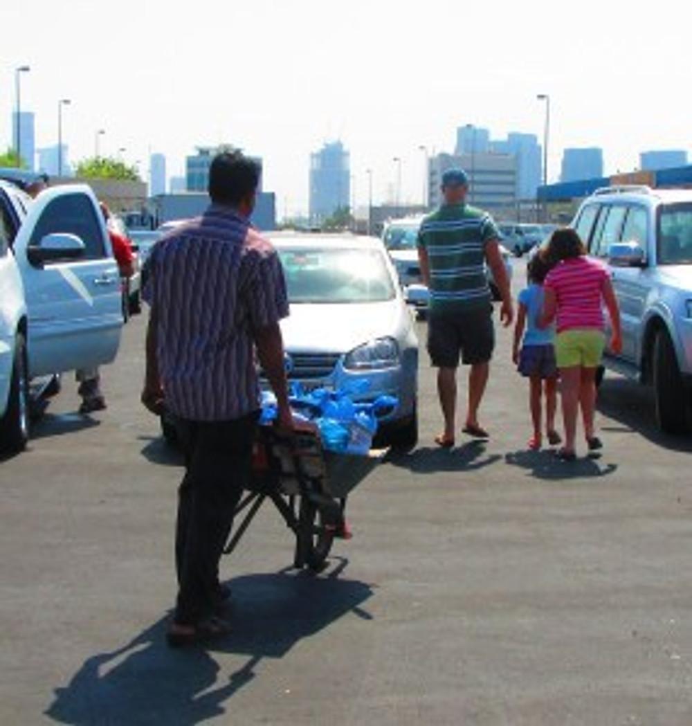 Produce valet by wheelbarrow