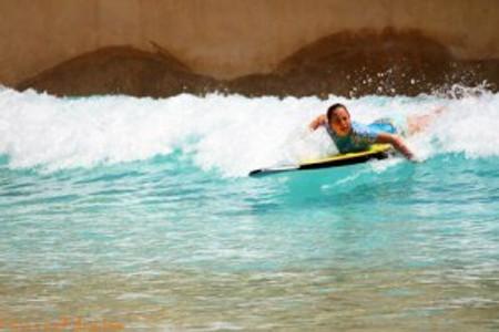Daughter paddling in