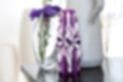 Purple and white candle with vase