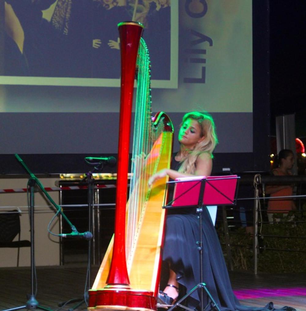 Harpist Playing at the Al Muneera Beach Bazaar