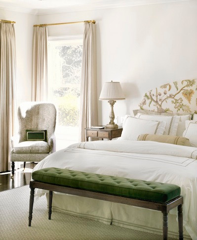 bedroom with green bench cushion
