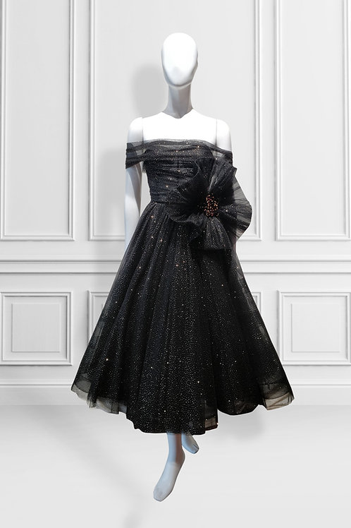 Sparkly tulle midi dress with shoulder drape and sculpted flower