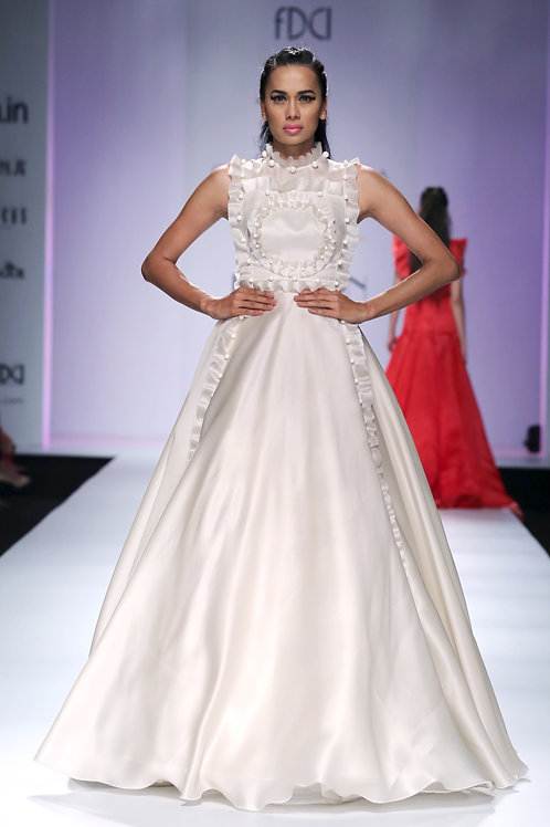 Voluminous gown with frill and pearl texturing and detailing