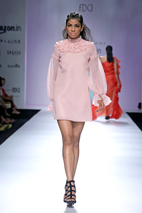 High collared shift dress with long pouf sleeves and pearl textured round bib