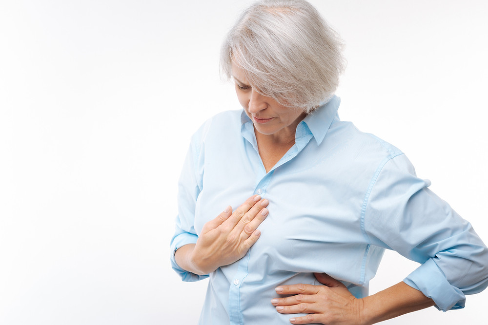 Woman in pain from acid reflux