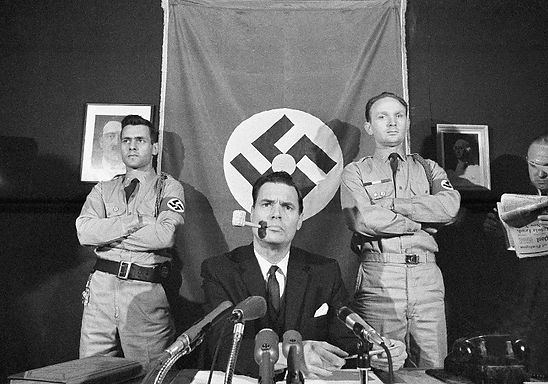 George Lincoln Rockwell seated at desk