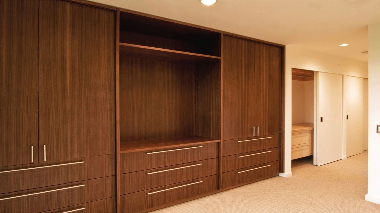 Natural wood fitted wardrobe.jpg