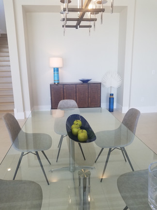 glass dining table in designer home