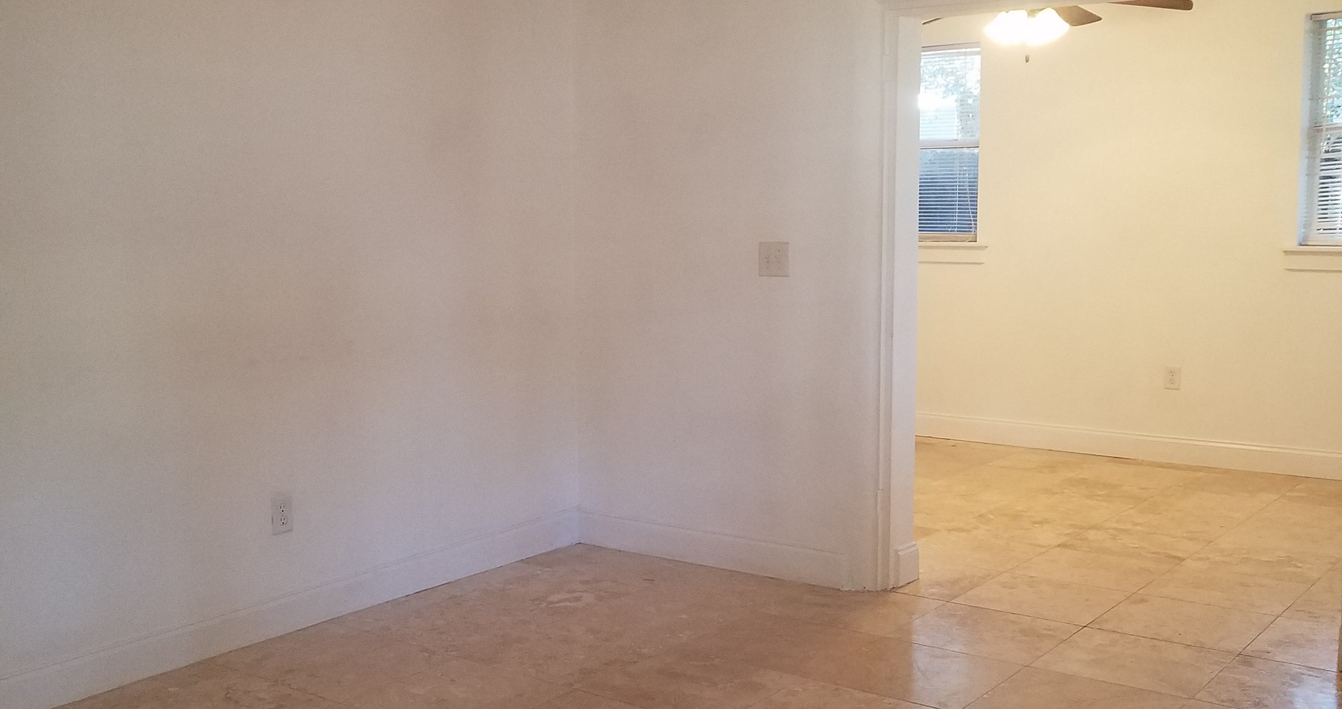 Empty living room before staging