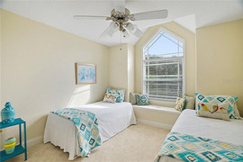 Guestroom in furnished home staged with new bedding