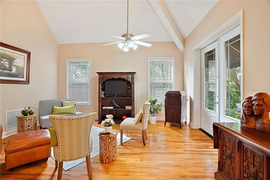 Great room in furnished home staged with additional furniture
