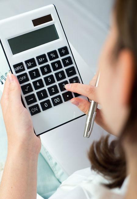 portrait-woman-with-calculator-pen.jpg