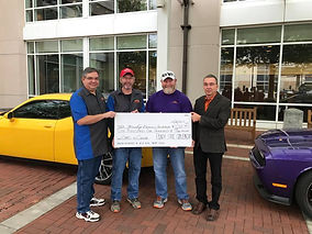 Presenting proceeds from 2nd Cars vs Cancer