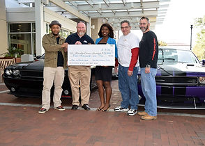 Presenting proceeds from 1st Cars vs Cancer