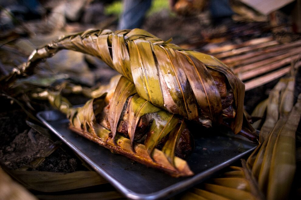 Matangi lovo pork, chickens and fish are wrapped in palm leaves then slow cooked underground