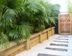 Capped retaining wall