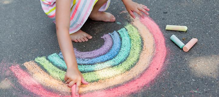 kid-drawing-sidewalk-chalk-colorful-rain