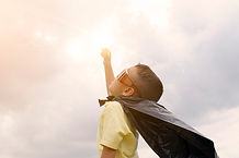 boy-superman-confidence-learning-play.jp