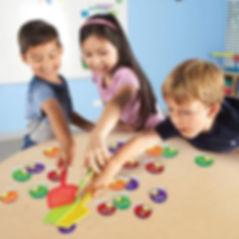 three kids playing word game.jpg