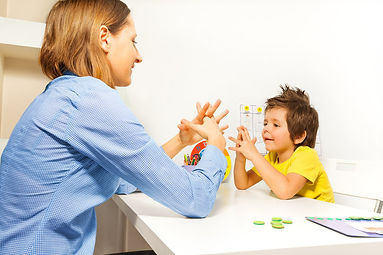 child-autism-table-work-fold-hands-thera