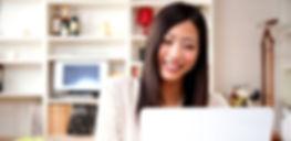 happy asian lady on laptop online tutori