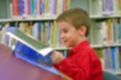 boy-library-happy-reading-tutoring.jpg