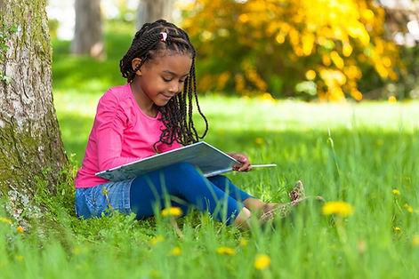 happy-girl-reading-outside.jpg