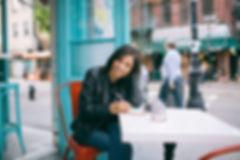 young-woman-writing-outside.jpeg