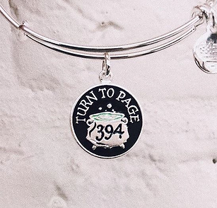 Turn to Page 394 designed by Emily Lopuch for Alex and Ani and Warner Bros.