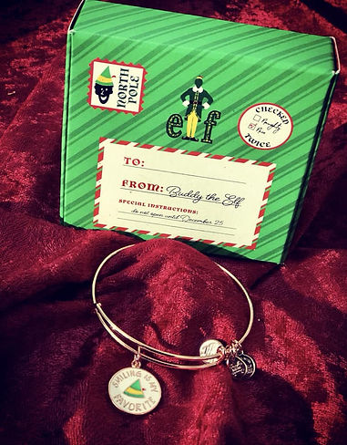 Smiling is my Favorite Elf jewelry designed by Emily Lopuch for Alex and Ani.