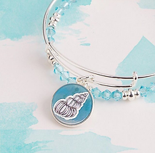 Seashell jewelry designed by Emily Lopuch for Alex and Ani.